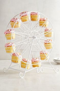 Here's an attraction everyone will want to take a turn with. Serve your wedding cupcakes in Pier 1's Ferris Wheel Cupcake Stand, and you'll have them lining up for more.