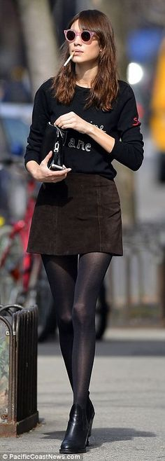 Dressed all in black Alexa Chung cut a retro figure as she strolled through the streets of New York on Tuesday.