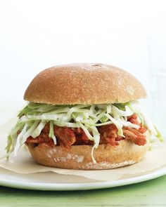 This version of pulled pork sandwiches uses tenderloin in place of pork shoulder to reduce the fat. Make the accompanying slaw with light mayonnaise.