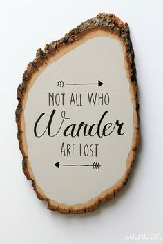 """DIY wood slice wall art. """"Not all who wander are lost"""""""
