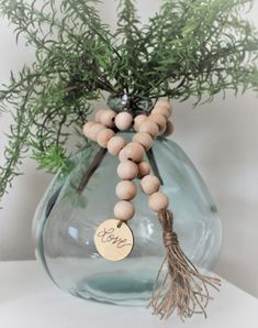 Come take a look at all the different ways you can style wood bead garland. Wood bead garland is the perfect accessory to add farmhouse charm. Wood Bead Garland, Beaded Garland, Diy Garland, Home Crafts, Diy And Crafts, Wooden Crafts, Christmas Crafts, Christmas Decorations, Snowman Decorations