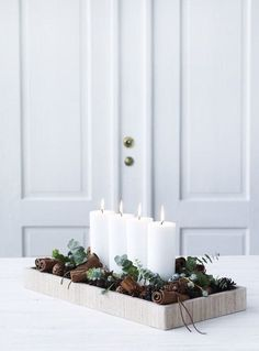 "A Minimalist Christmas: 12 Understated (But Still Gorgeous) Decorating Ideas | ""Decorating for the holidays"" often feels like an expensive and time-consuming undertaking, but there's another way to do Christmas: embracing the Danish concept of hygge (simple, cozy and comforting). Often nature-inspired and monochrome in look, check out these ideas for a Scandi-inspired, minimal holiday at home"