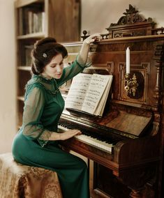 Girt at old piano Old Pianos, Music Instruments, Vintage, Musical Instruments, Vintage Comics