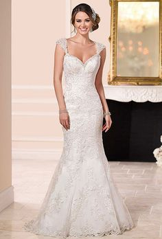 Stella York. See more details from Stella York��Lace-over-satin gown boasts sparkling diamant� accents along its sweetheart neckline, lace shoulder straps and low back.