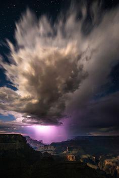 Rain falls from a thunderstorm cloud back lit by lightning creating a strange and eery visual effect. Grand Canyon by Schallau::cM: