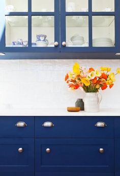 cobalt blue cabinets and marble countertops