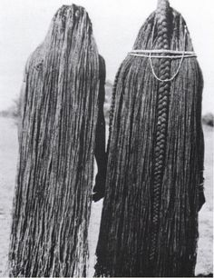 Two women whose braids have been lengthened to their ankles through the use of sinew (eefipa) extensions, Mbalantu of Wambo group, Namibia, Africa. Photo: M.Schettler, 1940's