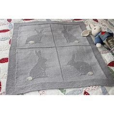 This adorable blanket has 4 embossed designs of bunnies, with a framed edging in garter stitch. One can optionally embroider the tails with a contrasting colour for an added interest.
