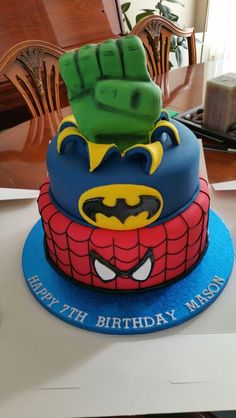 Superhero themed cake Spiderman captain America complete with