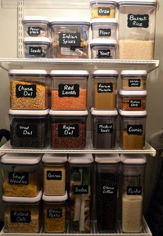 Stacking storage containers and chalkboard labels.