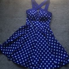 "Beautiful blue polka dot dress from Guess Gorgeous Aline dress classy and sexy . Wore twice . Very good condition . Got a lot of compliments . Dress has a built padded  bra . I am a size cup 34 b .  Length is 33"" from straps . Guess Dresses Mini"