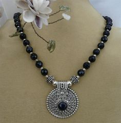 Faceted purple goldstone and large silver pendant necklace