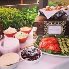 We are crazy about our bagel stateion that we served at a bridal brunch this past weekend. We served an assortment of bagels with our sundried tomato and pesto cream cheese topped with fresh cucumber, tomatoes, and basil. YUM!