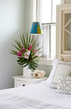 How to decorate with palm fronds and palm leaves. Inspiration for every room, featured on Completely Coastal. Real and faux artificial palms, both work!