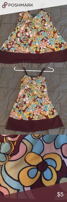 Wet Seal spaghetti strap babydoll cami! Retro floral print on brown background! Babydoll style helps to conceal those muffin tops (if you have them)! One knick in the fabric as seen in picture 3! Feel free to ask questions! Wet Seal Tops Camisoles