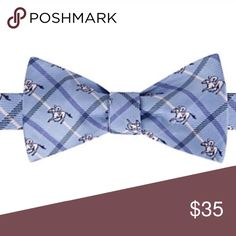 Bow tie blue plaid horse racer Product Details Stand out in a crowd with this men's Bow Tie Tuesday bow tie.   PRODUCT FEATURES Self-tie design FIT & SIZING Adjustable strap FABRIC & CARE Polyester Dry clean Other