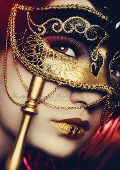 Gold and black mask on a stick