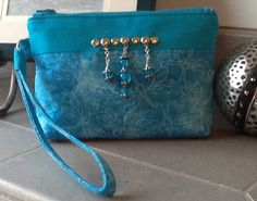 """""""Dragonfly Dreams"""" is a peacock blue wristlet adorned with sparkling blue glass beads and a row of silver nail heads.  This color is absolutely stunning!  Want to see more?  Find me on Facebook at Bobbin My Thread!"""