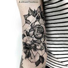 Floral geometric prism diamond back of arm tattoo