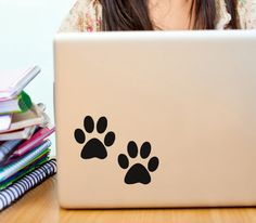 Paw print vinyl decals for dog or cat owners, car window, treat jars and more on Etsy, $5.00