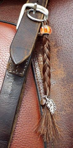 """The """"Anna"""" style keychain features a regular braid with a glass bead or jewel bead on top and accented with a charm at the bottom of the braid. Horse Hair Bracelet, Horse Hair Jewelry, Horseshoe Crafts, Horseshoe Art, Hair Keepsake, Horse Hair Braiding, Bracelet Making, Jewelry Making, Horse Crafts"""