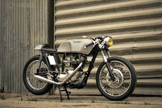 Mean and lean Triumph Cafe Racer.  Not fast by today's standard but it was the fast standard during the 60's.