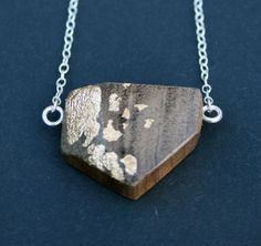 Wood and Gold Shield Necklace by ohsomeday on Etsy, £25.00
