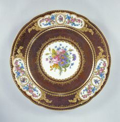Plate (assiette d'echantillons); Ground color painted by Antoine Capelle (French, active 1745 - 1800), Flowers painted by Jacques-François-Louis de Laroche (French, about 1740 - about 1802), Gilded by Henri-Martin Prevost the younger (French, active 1757 - 1797), et al; Sèvres, France; 1782; Soft paste porcelain, brown ground, polychrome enamel decoration and gilding; J. Paul Getty Museum, Los Angeles, California
