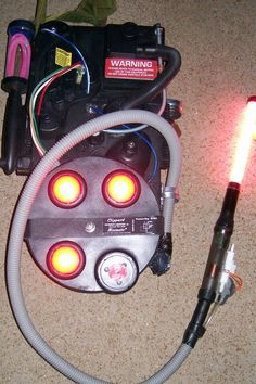 Ghostbusters proton pack I made for my son's Halloween costume. Used frame from rolling duffle bag, Molly pack straps from military resale store, round cookie tin, cardboard box, pop lights, random stuff from around the house, kids light wand, lots of flat black spray paint and printed stickers from internet. Happy Ghostbusting!