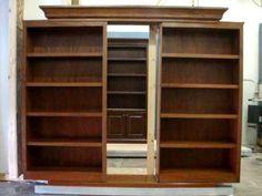 Sliding bookcase doors reveal hidden passage
