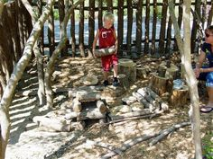 "Natural Out door play area full of fun ""junk"" to play and create with."