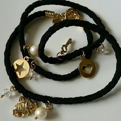 Wrap around bracelet 18k gold plated Charms are 18k gold plated, comes with crystals and pearls, on silk rope, different, and looks like a million bucks. Jewelry Bracelets