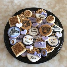 """Safari themed birthday. Fondant Bow molds from @maisondubonbon  #safari #cheetahprint #cheetahcookies #safariparty #safaricookies #safaritheme #sandiego #natsweets #customcookies #cookieart #cookieplatter #leapard #leapardprint"" Photo taken by @natsweets on Instagram, pinned via the InstaPin iOS App! http://www.instapinapp.com (07/19/2015)"