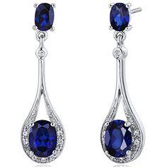 Revoni- Glamorous 5.00 Carats Blue Sapphire Oval Cut Dangle CZ Earrings in Sterling Silver