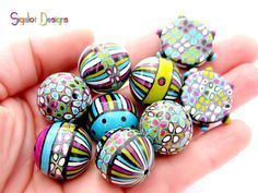 Paradise- mixed shape handmade polymer clay beads.