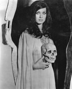 Valerie Leon holds a skull in publicity shot for Hammer's Blood from the Mummy's Tomb (1971).