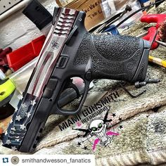 """who-loves-guns-i-love-guns: """" #Repost @smithandwesson_fanatics ・・・ From @miamigunsmith S&W M&P 45. Slide refinished in a Distressed American Flag, Frame Stippled and refinished in a Two Tone Cerakote..."""
