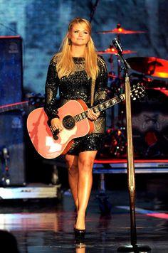 Miranda Lambert, I would LOVE to go hunting with her a Blake Shelton