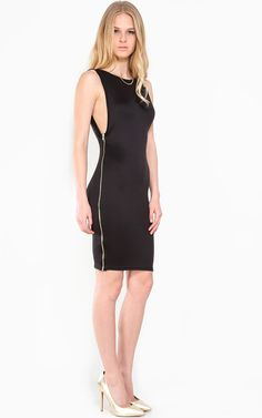Absolutely love this simple black dress with the gold pumps!    MakeMeChic.com