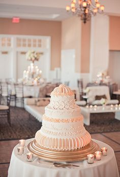 Peach sugar flower-decorated wedding cake by pastry chef Scott Hunter. Weber Photography