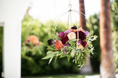 Mid-Century Modern Wedding Inspiration from Palm Springs | hanging flowers in burgundy, cream, lavender and peach via Green Wedding Shoes