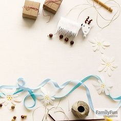 """Place lengths of silky sky-colored ribbon on the table to stand in for """"blue satin sashes,"""" while some small treat boxes (filled with movie candy, perhaps?) covered in kraft paper and twine can evoke those famed """"brown-paper packages tied up with strings.""""                 Originally published in the February 2015 issue of FamilyFun magazine."""