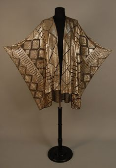 This is lovely - and a good photo that really shows the shape of the garment.       EGYPTIAN ASUITE COCOON SHAWL, c. 1920 Black cotton