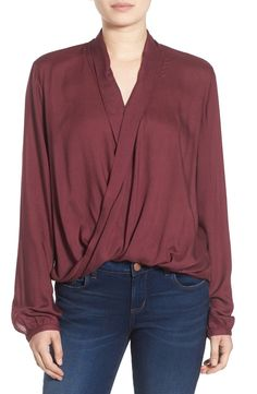 In love with the burgundy color of this sophisticated blouse from the NSale. Layer on a statement necklace for a chic look!