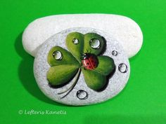 Painting on Stone ladybird on clover by Lefteris Kanetis.