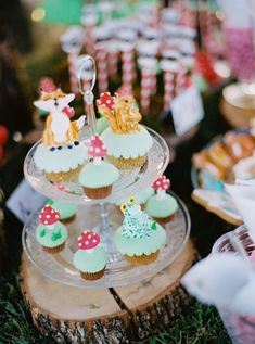 """Cute little """"animal"""" and """"mushroom"""" cupcakes to give a """"woody"""" feeling to a fairytale baptism! #eliteeventsathens #inthewoods #fairytale #story #magic #baptism #christening #eventplanning #decoration #candybar #desserts #cupcakes #athens #greece"""