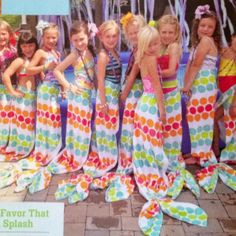 Mermaid party favor made from beach towel with Velcro waist tab & pony holders to make tail.