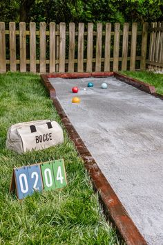 How to build a backyard DIY bocce ball court / horseshoe pit in a weekend for fun-filled outdoor gatherings.