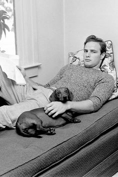 """ Marlon Brando and his Doxie Maria photographed 1949"""