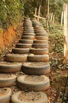 Lots of old tires become stairs staircase in the garden or yard in the woods.  Upcycle, recycle, repurpose, salvage, diy!  For ideas and goods shop at Estate ReSale & ReDesign, Bonita Springs, FL
